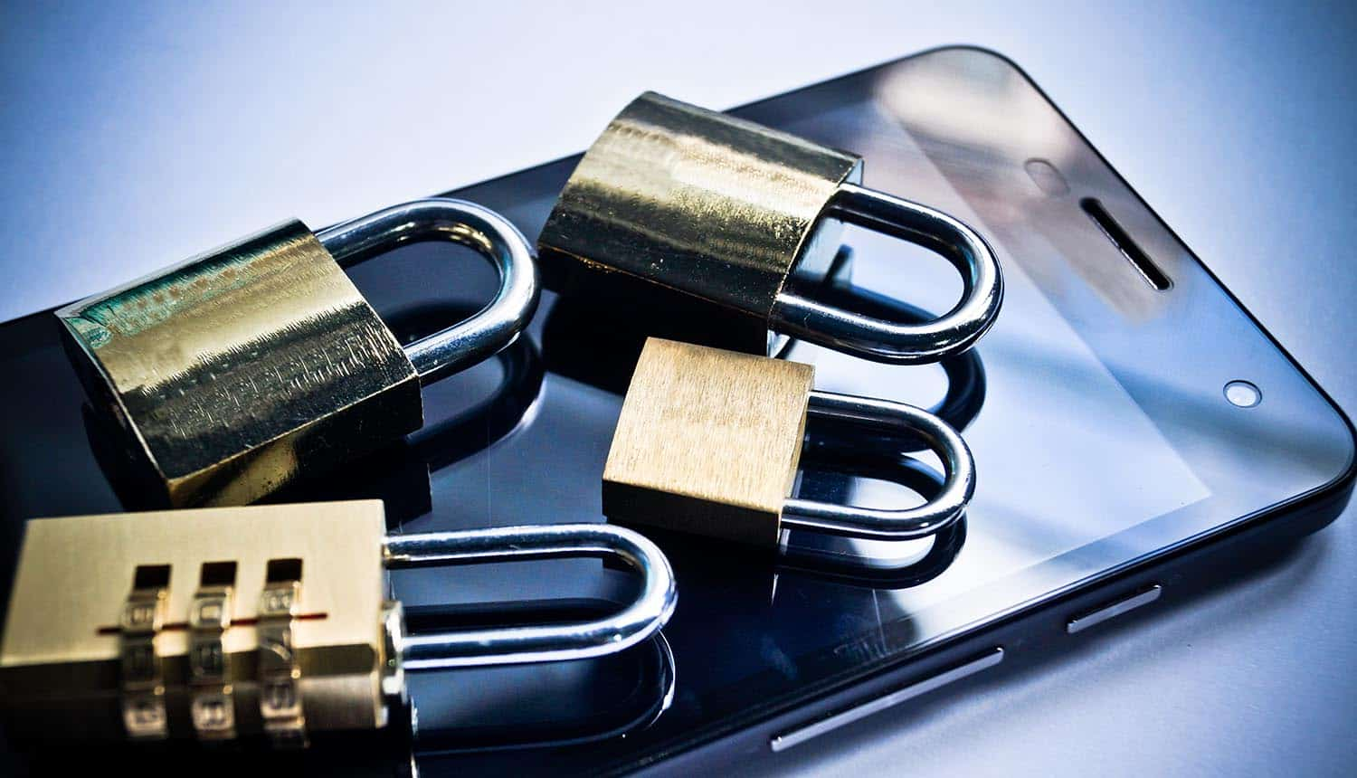 Metal security locks on a smartphone showing mobile security during pandemic