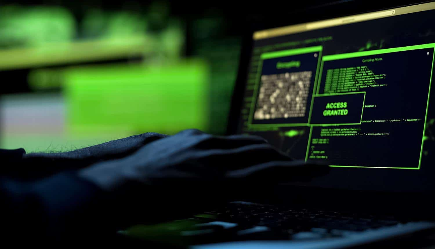 Close-up hacker hands working on laptop showing Ubiquiti data breach