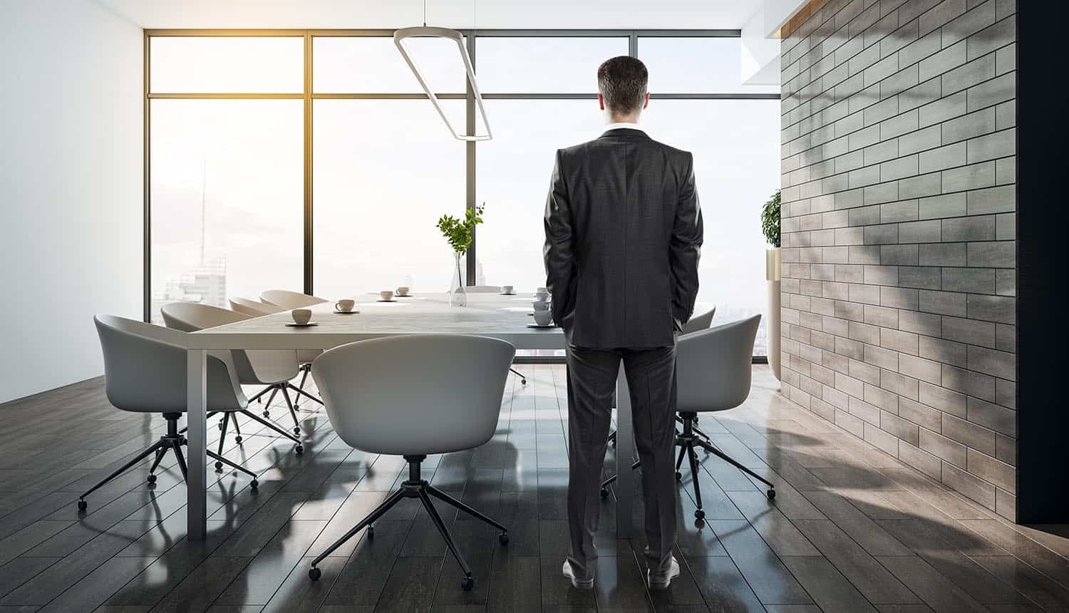 Businessman standing in conference interior with city view showing data protection in a security-first future