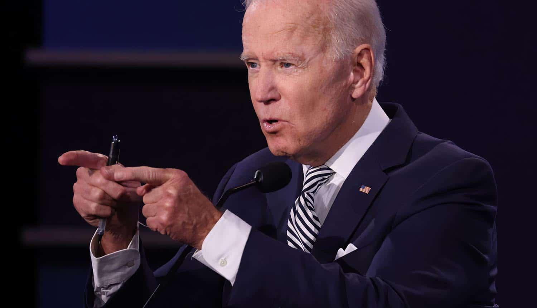 Joe Biden at Presidential Debate showing executive order on cybersecurity breaches
