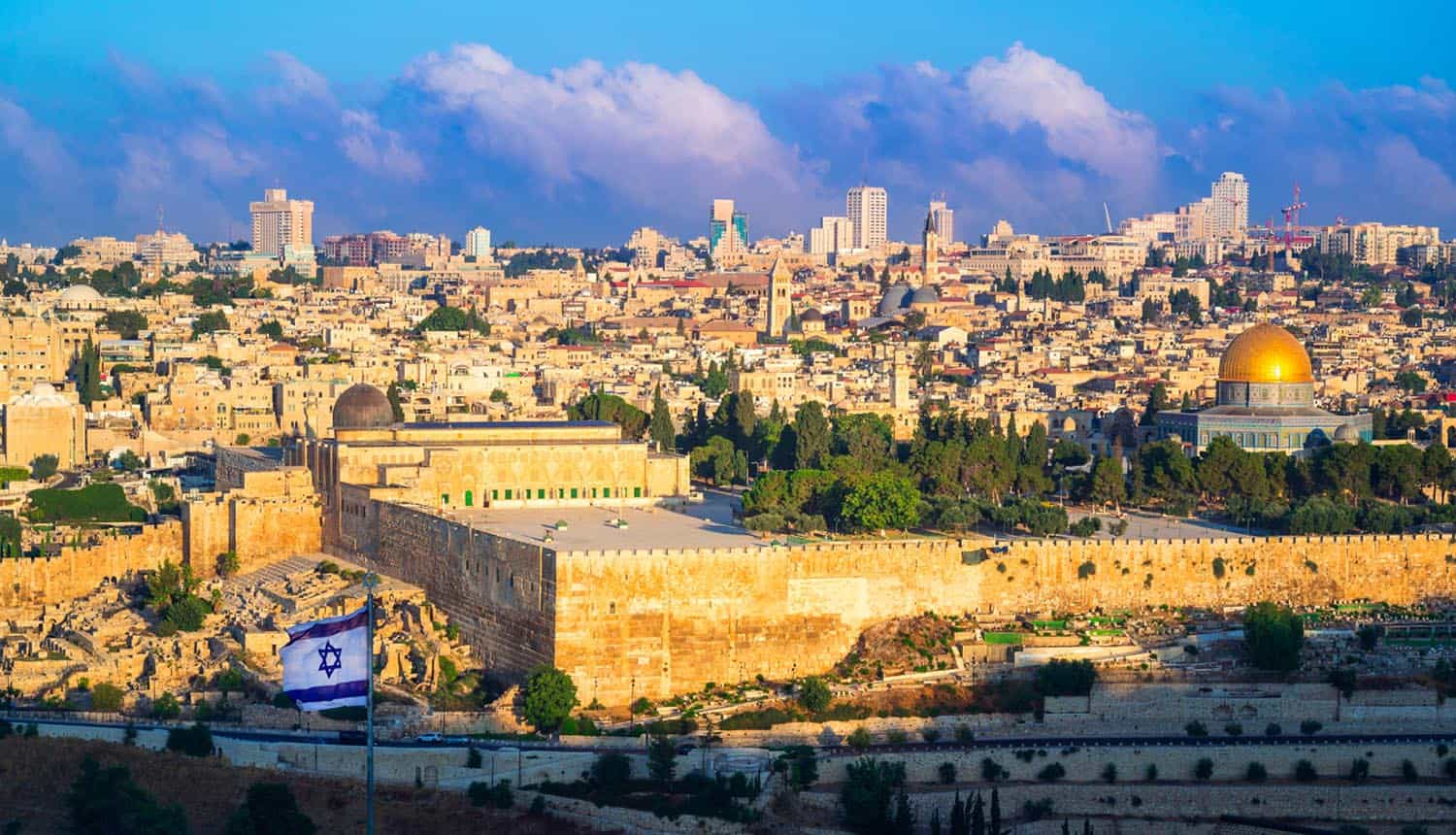 Flag of Israel flying over city showing ransomware gang cyber attack