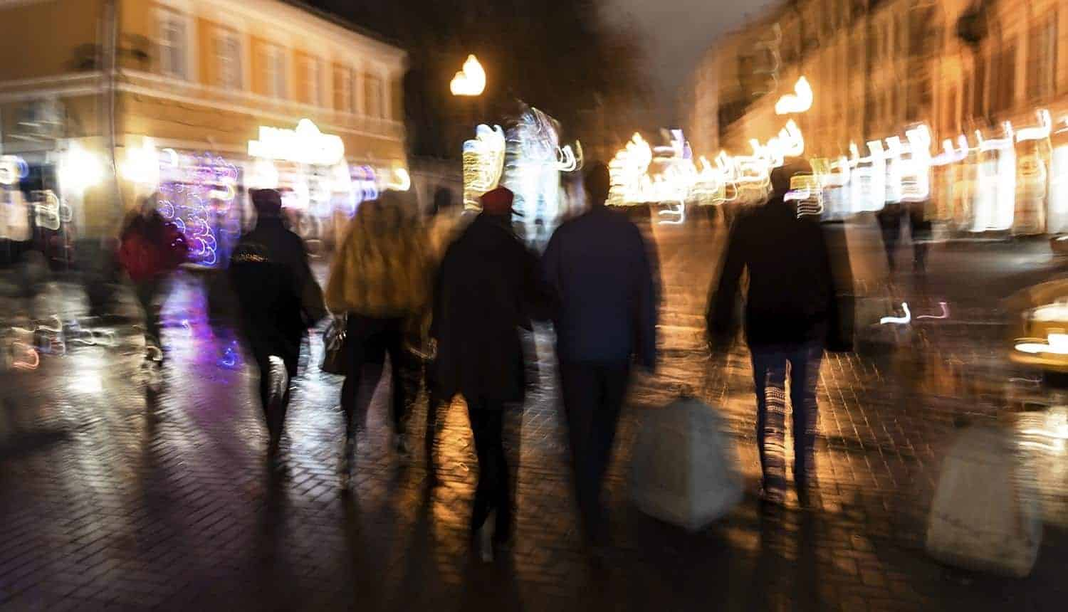 People in the evening on the streets of the city showing shift to zero party data for personalization