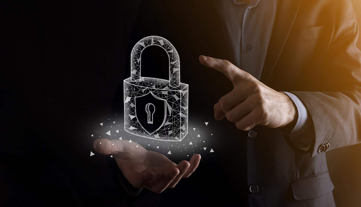 Hands holding a digital padlock showing endpoint security practices for stopping cyber attacks