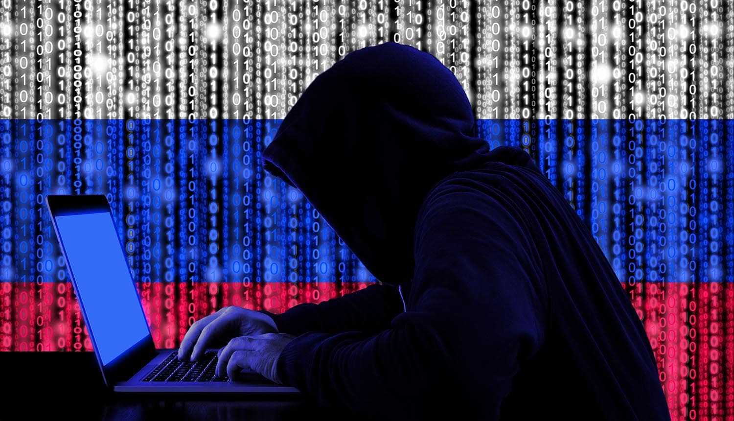Russian hackers in a dark hoody sitting in front of a notebook with digital Russian flag and binary streams background showing cybersecurity advisory warning