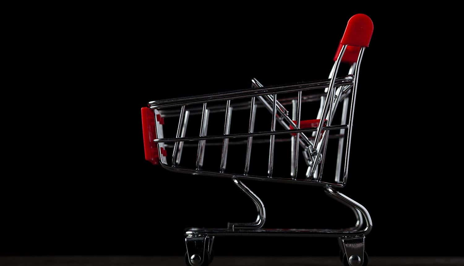 Dark background image with an empty toy shopping cart showing use of guest checkout and ad blockers