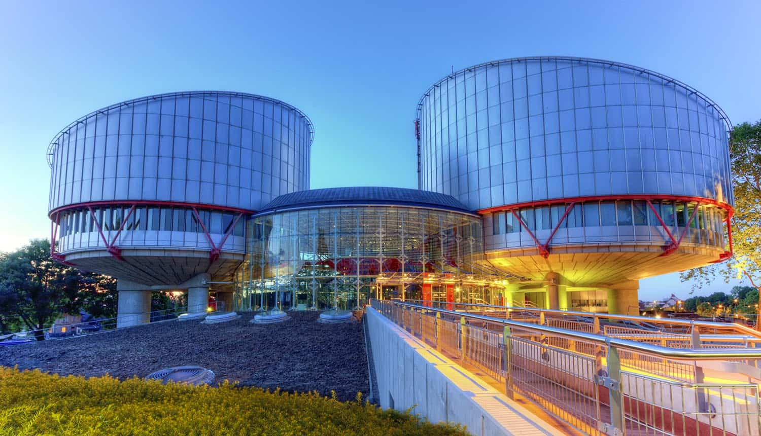European Court of Human Rights building by night showing GCHQ decision on mass surveillance