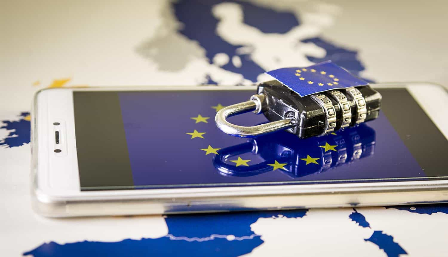 Padlock over a smartphone and EU map showing GDPR complaints on cookie banners