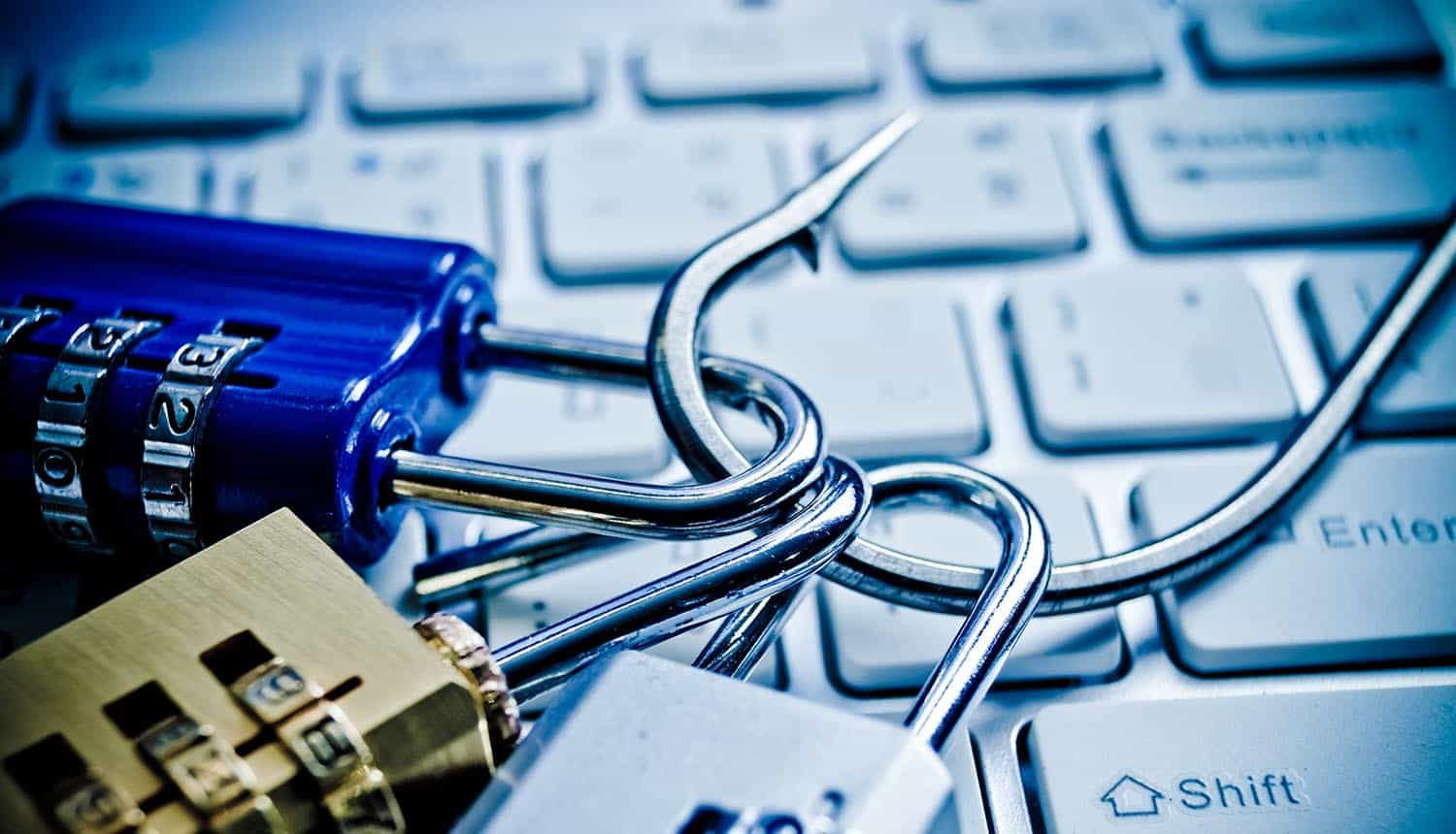 Security locks with a fish hook on computer keyboard showing credential phishing using compromised accounts