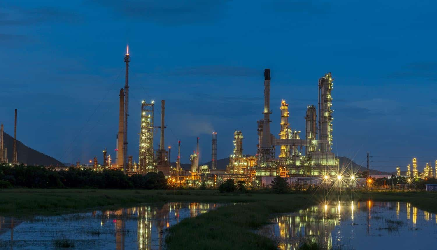 Oil refinery gas petrol plant industry with crude tank, gasoline supply and chemical factory showing cyber-physical security for critical infrastructure and healthcare