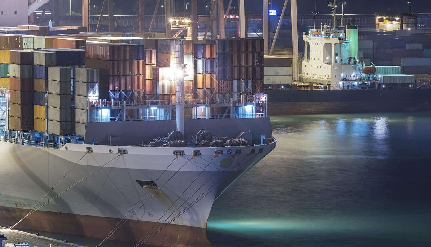 Cargo port in Hong Kong at night showing maritime cyber attacks