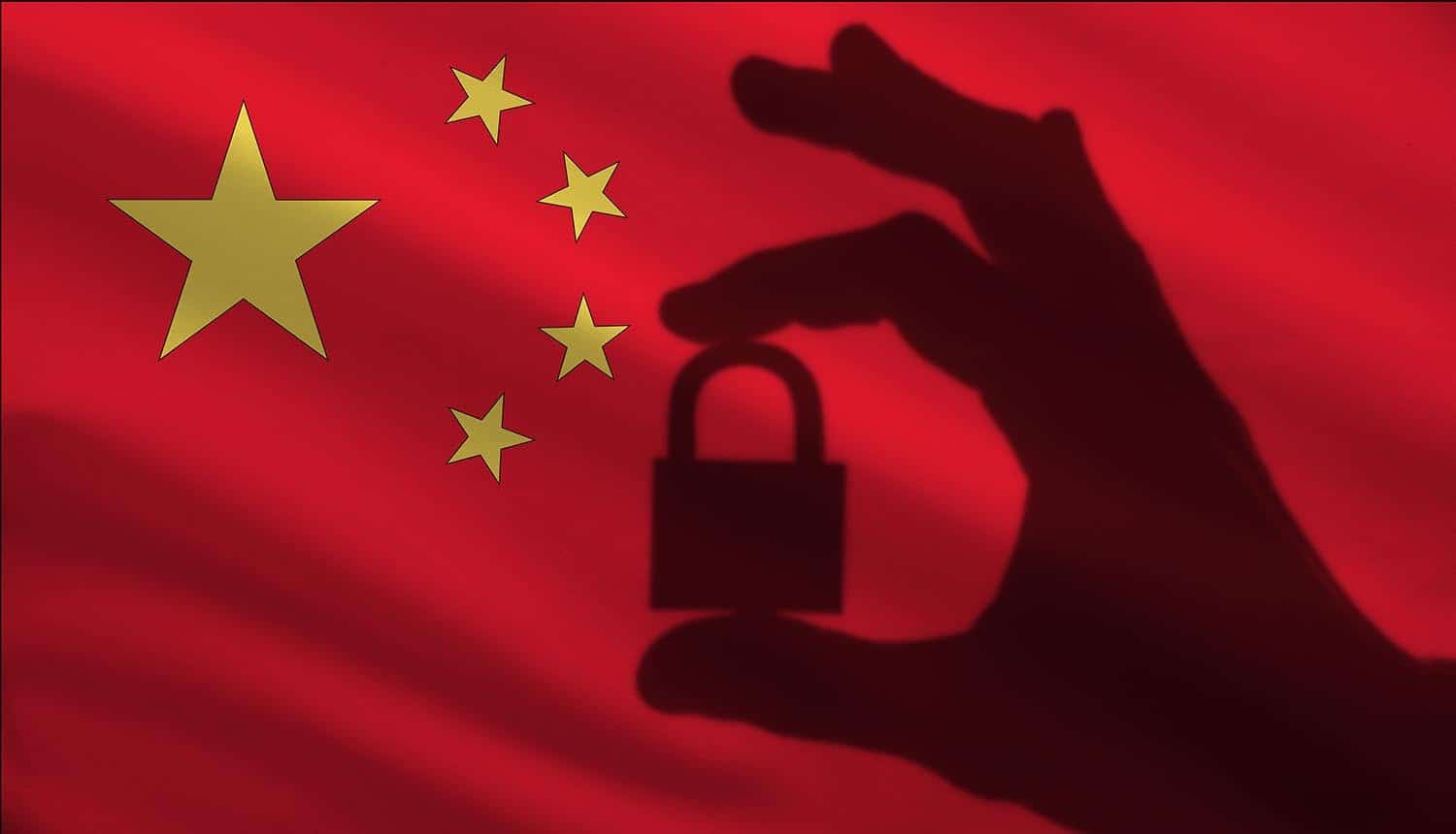 Closed lock in the hand against China flag showing data security law on tech giants