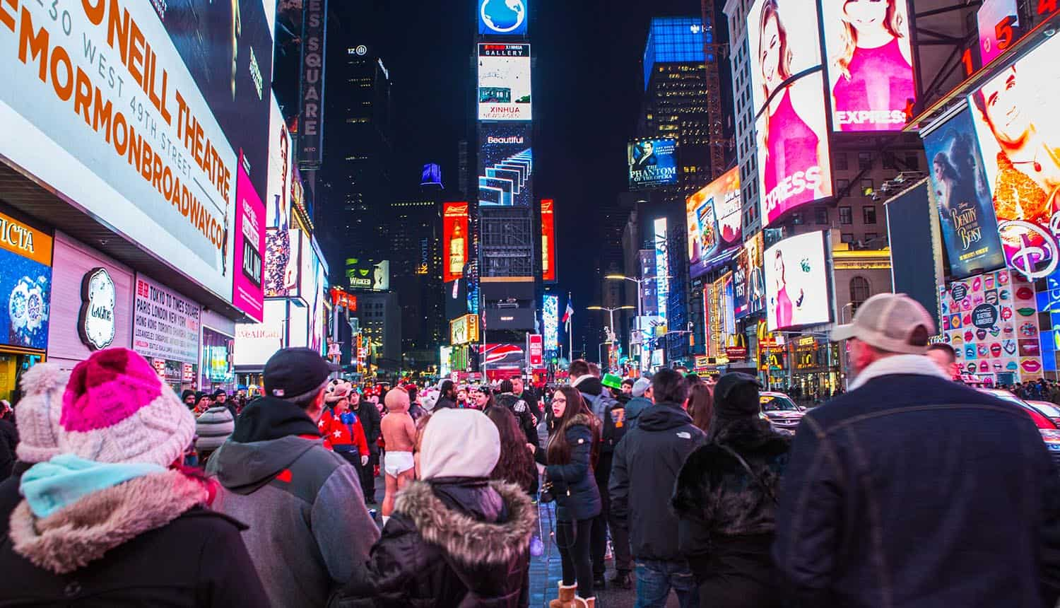New York Times Square featured with broadway theaters and animated colorful LED signs showing Big Tech facing data tax