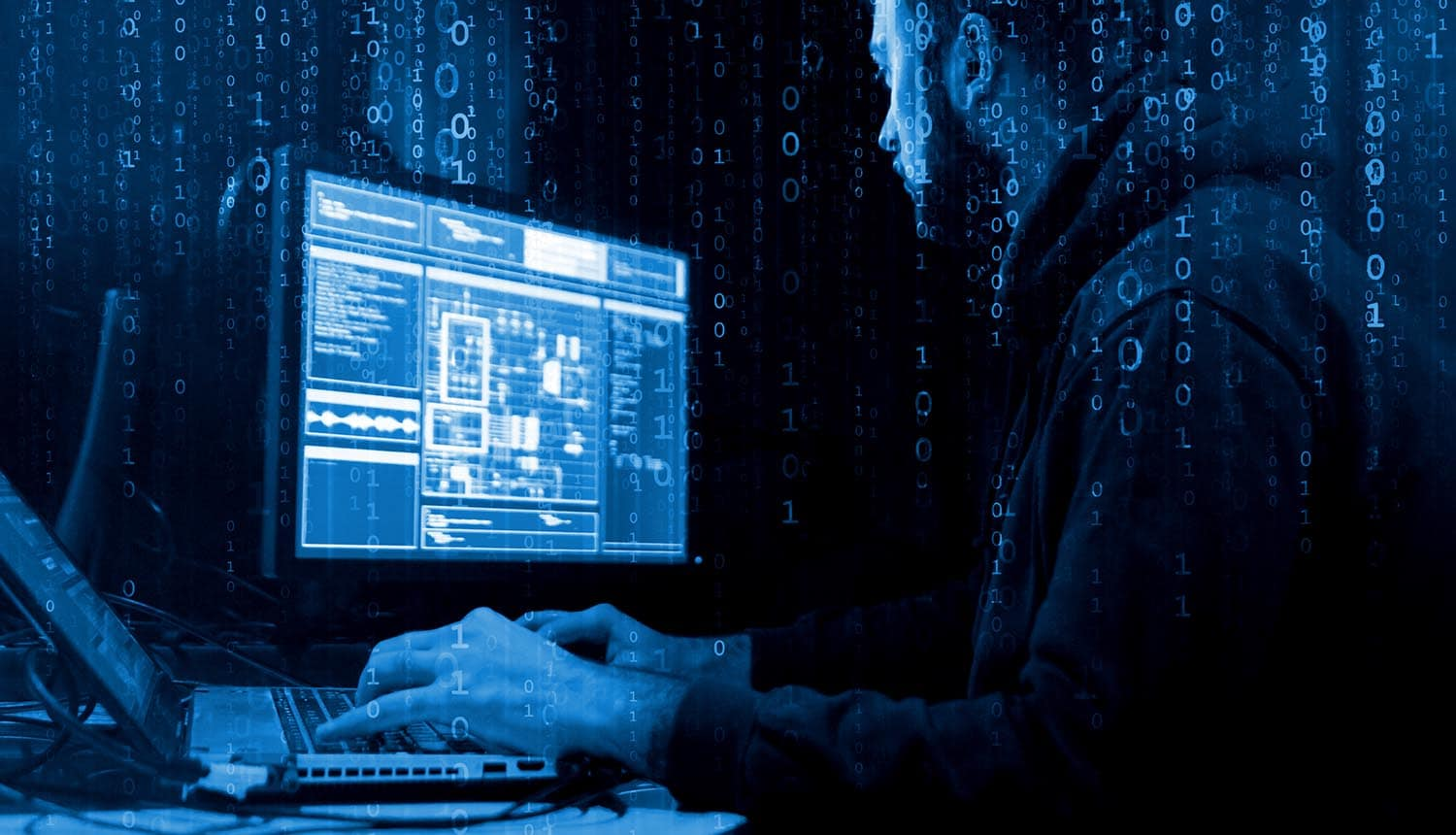 Hackers breaking server using computer showing cyber attacks on critical infrastructure