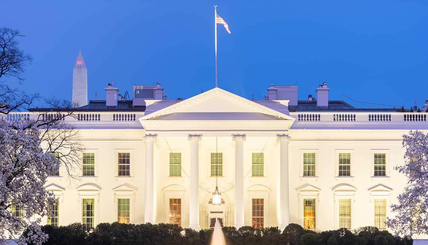 White House in spring season at twilight showing open letter on ransomware attacks on critical infrastructure