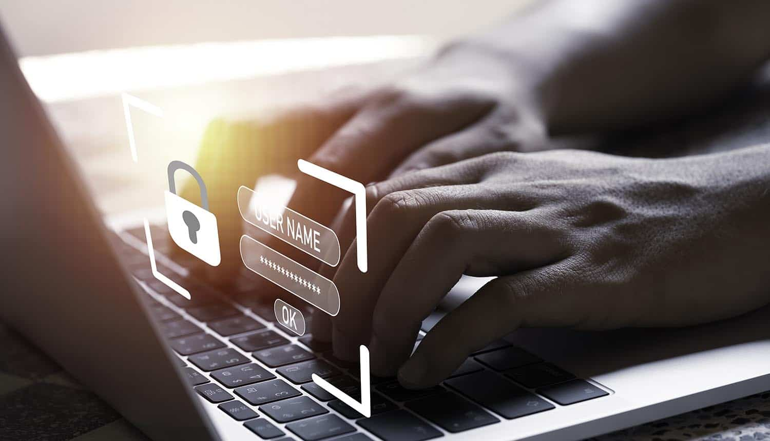 Hand with virtual master key for using laptop computer showing cloud security and data breach
