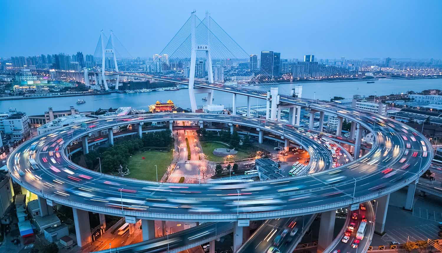 Shanghai Nanpu bridge with busy city traffic showing Didi problems with data protection rules