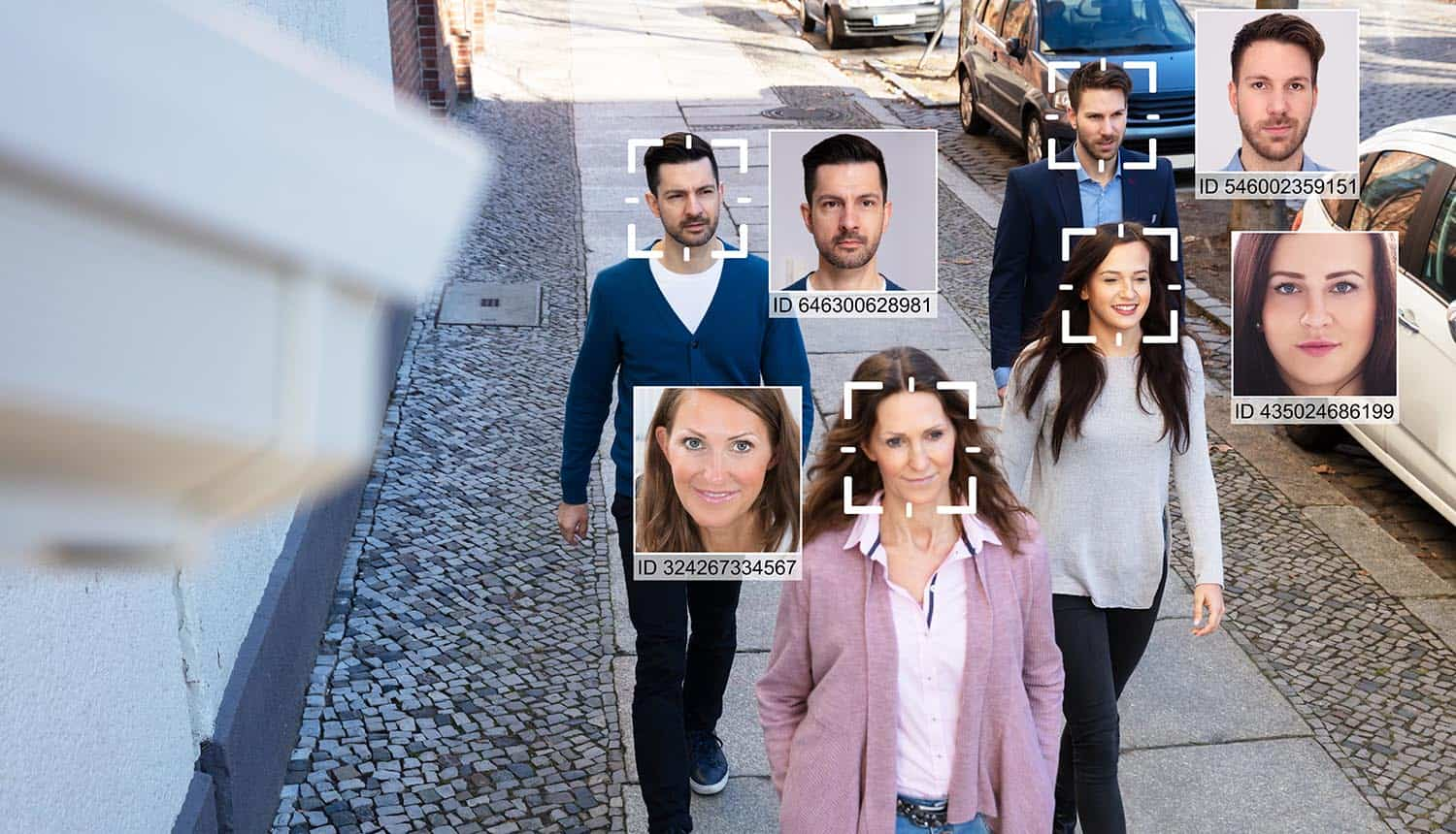 Selective focus of people faces recognized on the street showing use of facial recognition technology