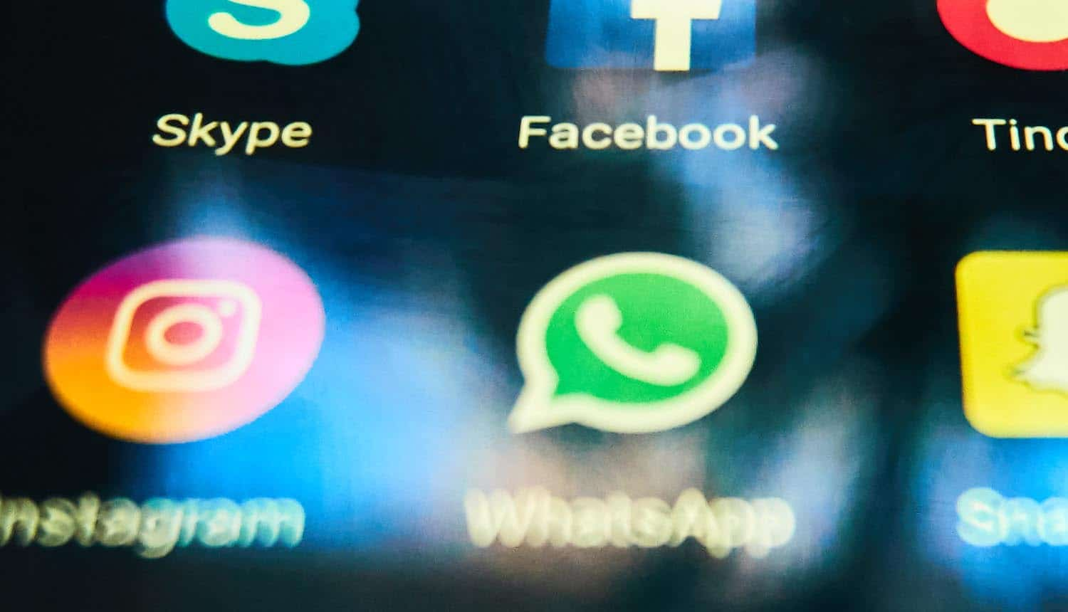 WhatsApp app icon on smartphone showing consumer complaints on privacy update