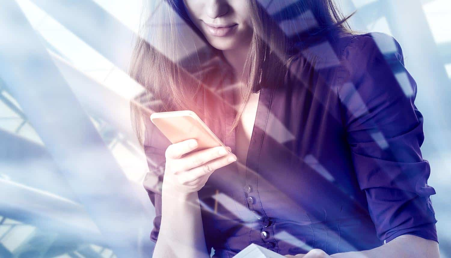 Woman using smartphone with digital business interface showing cookies for personalization