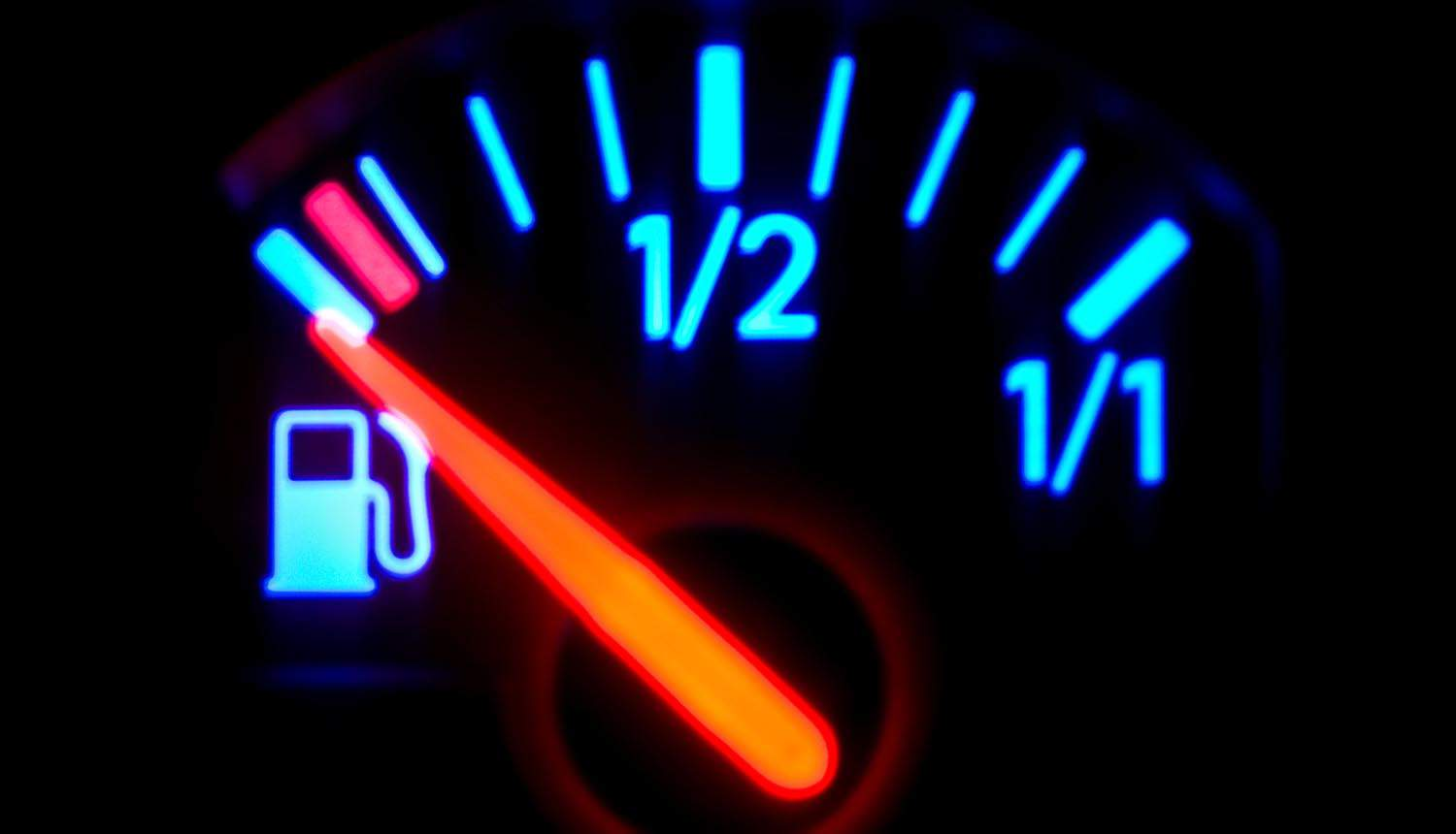 Fuel gauge on vehicle dashboard showing TSA security directive for pipeline operators