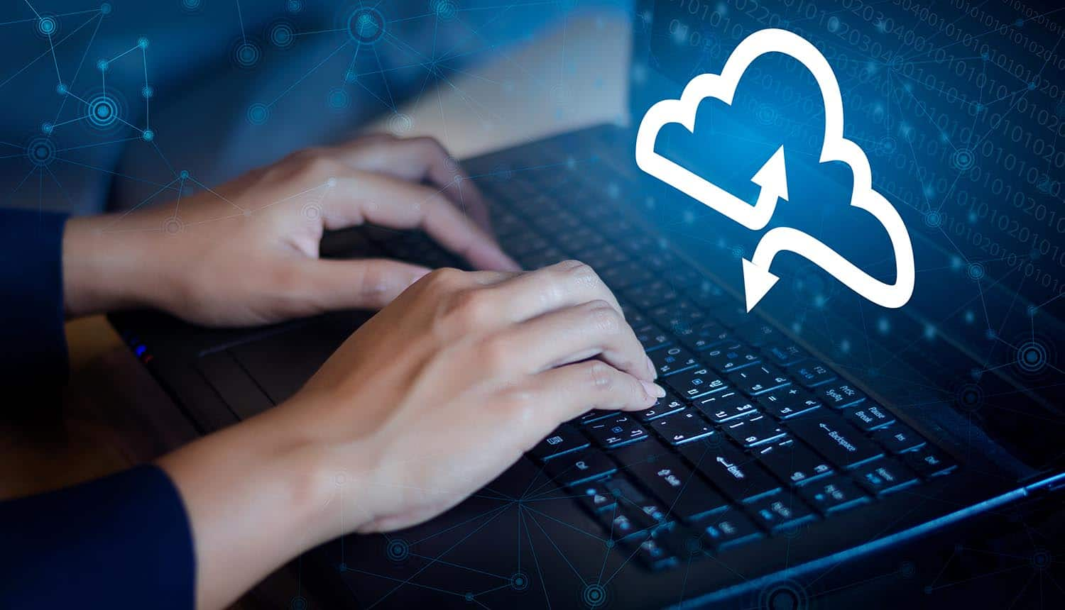 Hand on keyboard with cloud icon on monitor screen showing SaaS and shadow IT