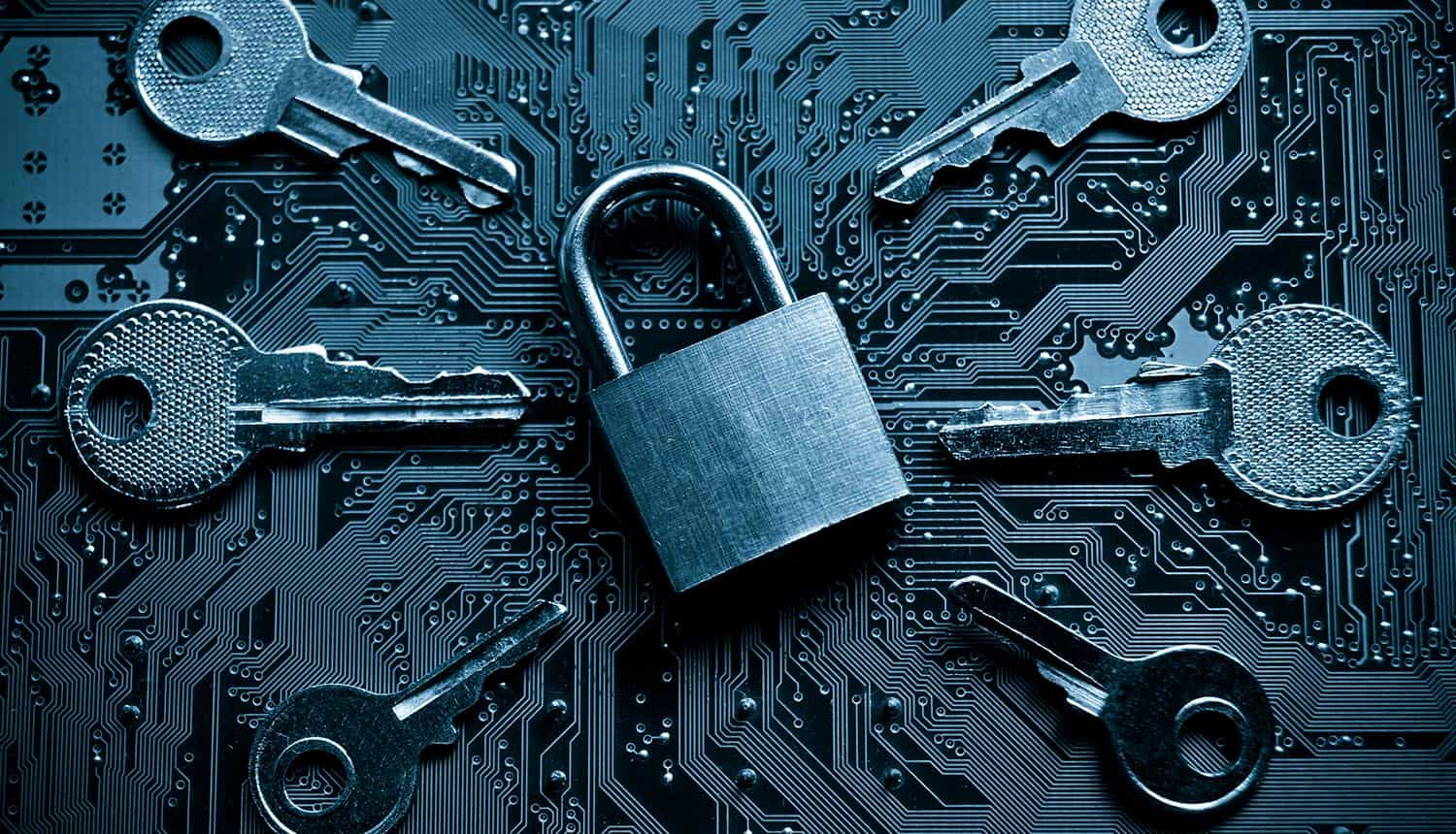 Security lock on a computer circuit board surrounded by keys showing bad passwords
