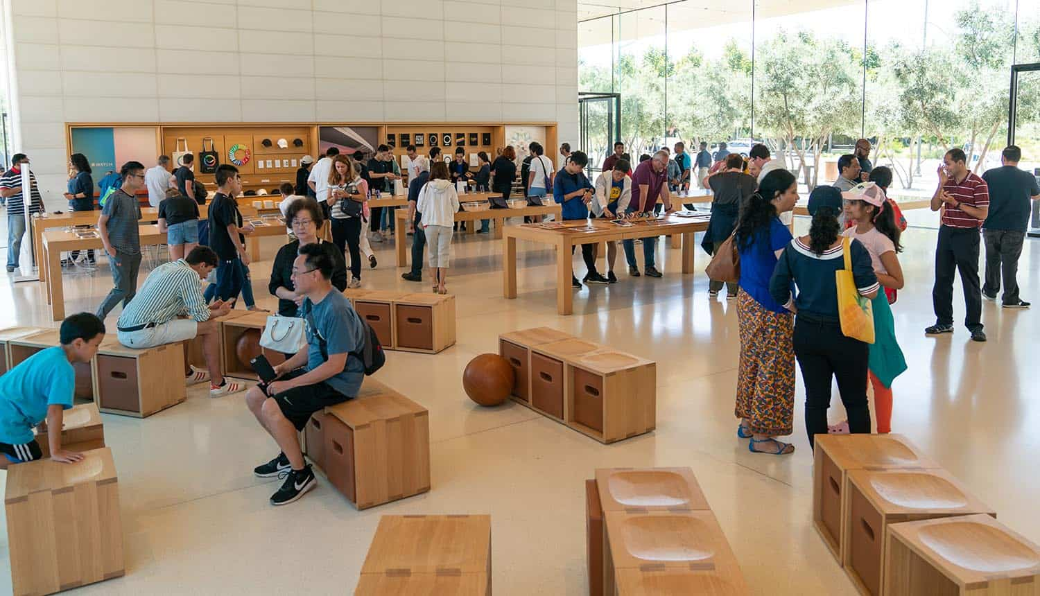 Group of people in Apple Store showing mass surveillance concerns with iCloud Photos scan