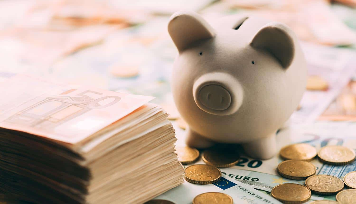 Piggy bank with cash and coins showing cost of data breach