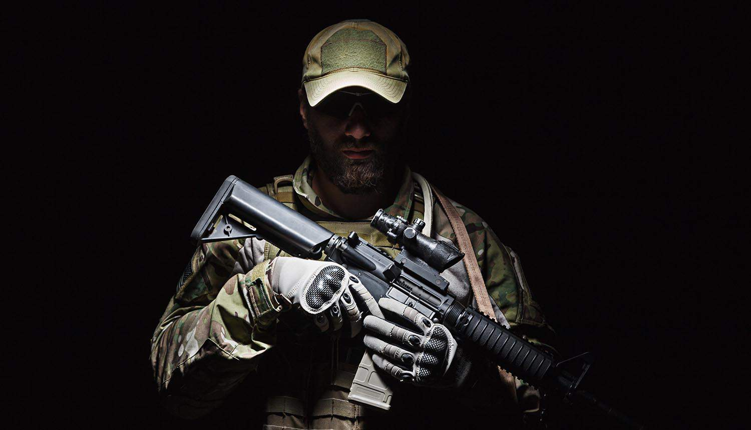 Soldier holding rifle showing national security and attack on critical infrastructure can lead to shooting war