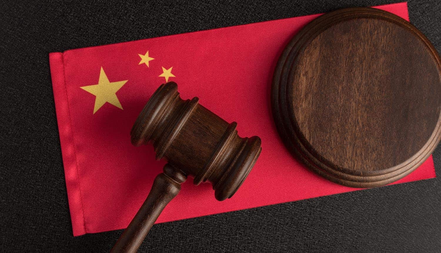 Judge gavel on the China flag showing data protection law impacting tech firms