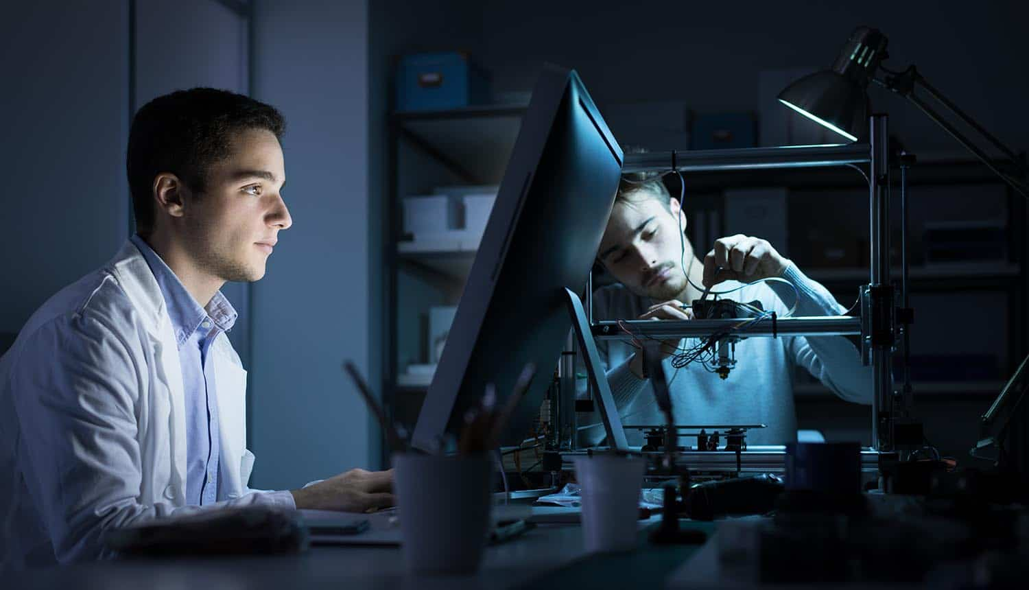 Engineering team working in the lab at night showing continuous testing and automation