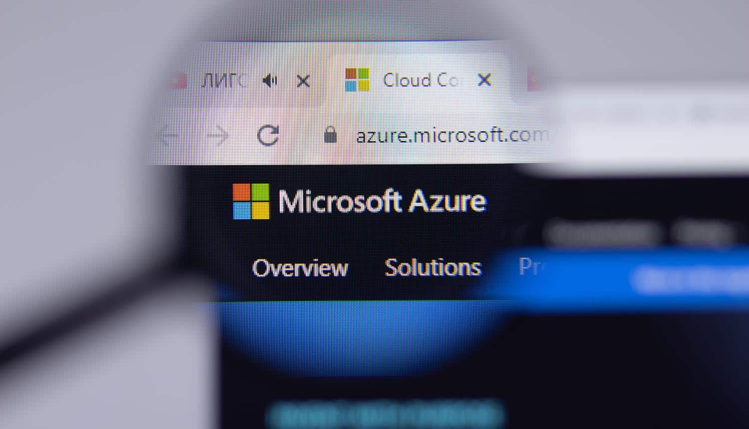 Microsoft Azure logo close-up on website page showing vulnerability with Cosmos DB cloud databases