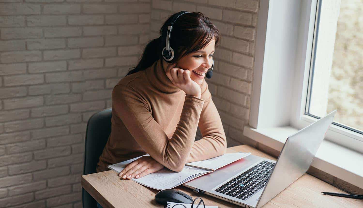 Young woman having video conferencing call showing cybersecurity shortcuts while remote working