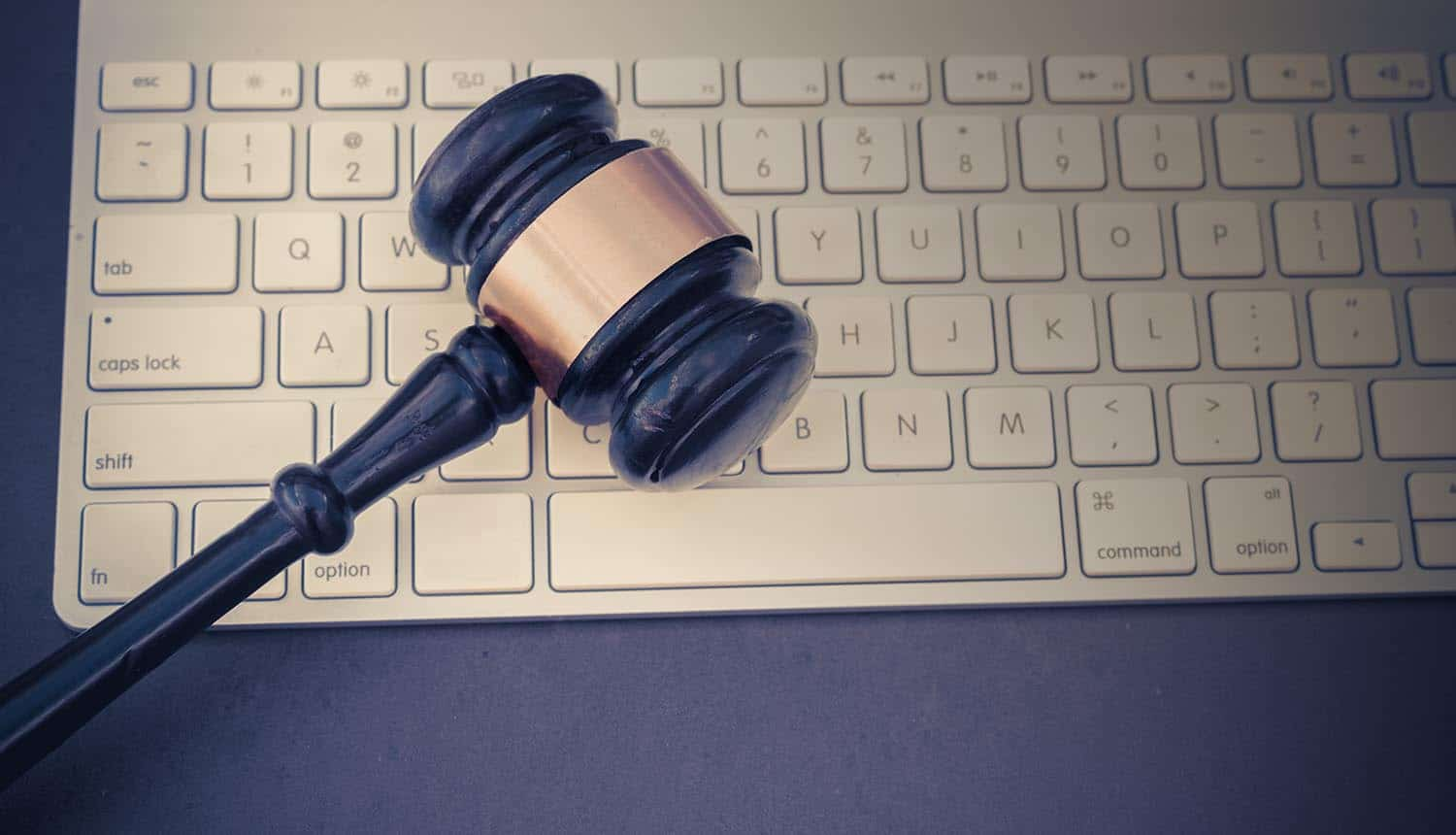 Gavel on keyboard showing privacy legislations and need for zero-party data (ZPD)