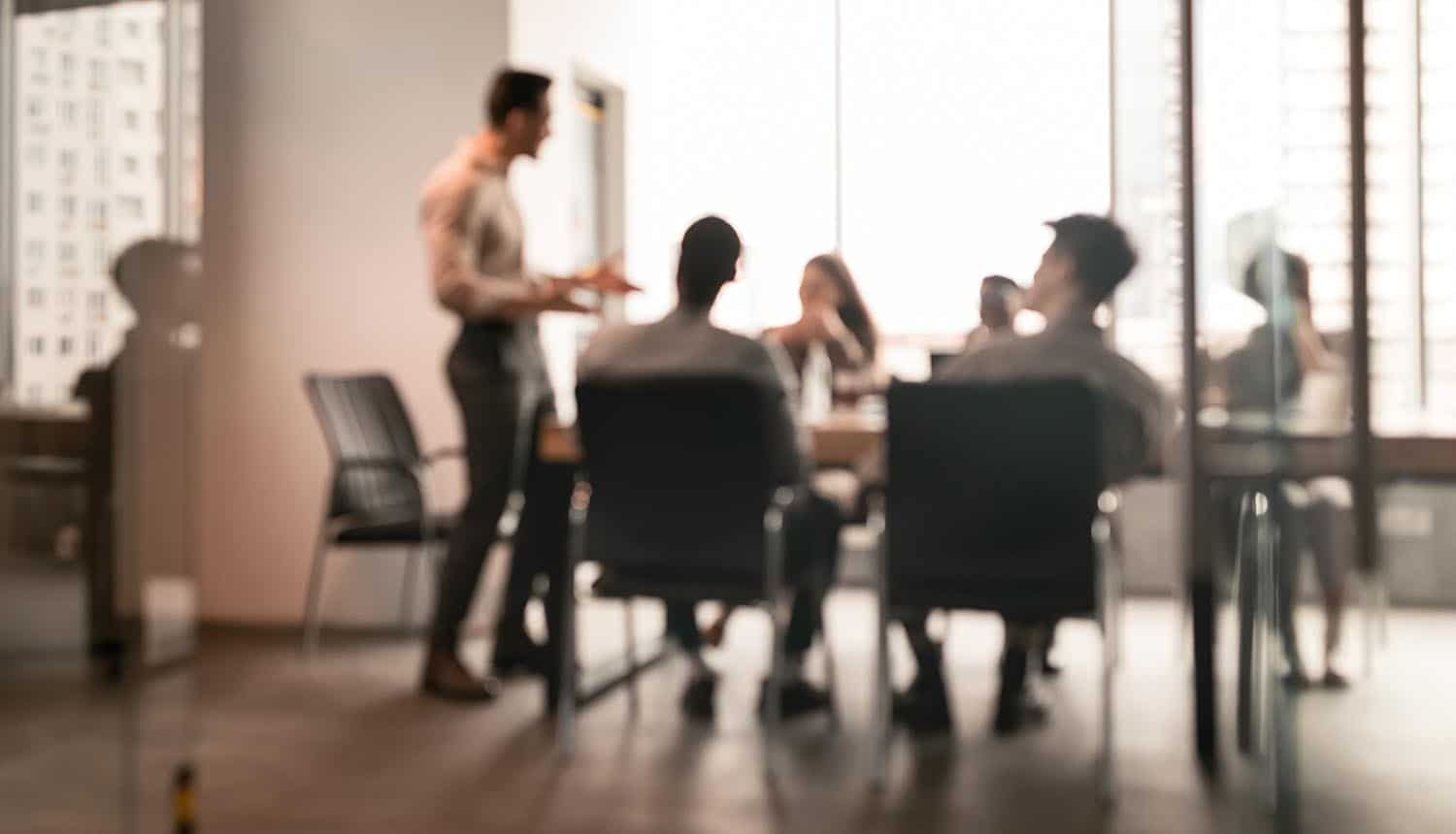 Colleagues having meeting in boardroom showing ransomware issue