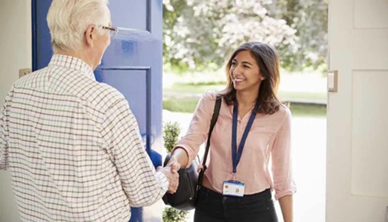 Healthcare worker visiting patient