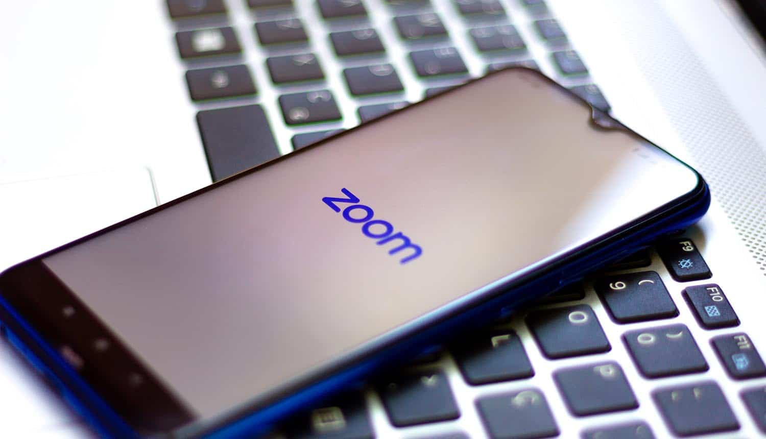 Zoom logo displayed on a smartphone showing privacy lawsuit on zoombombing