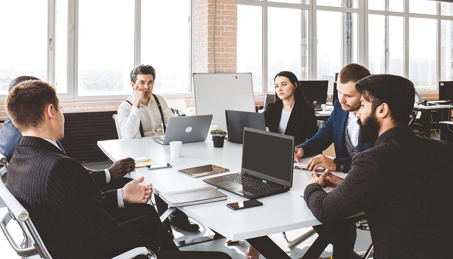 Group of business people working and communicating in boardroom