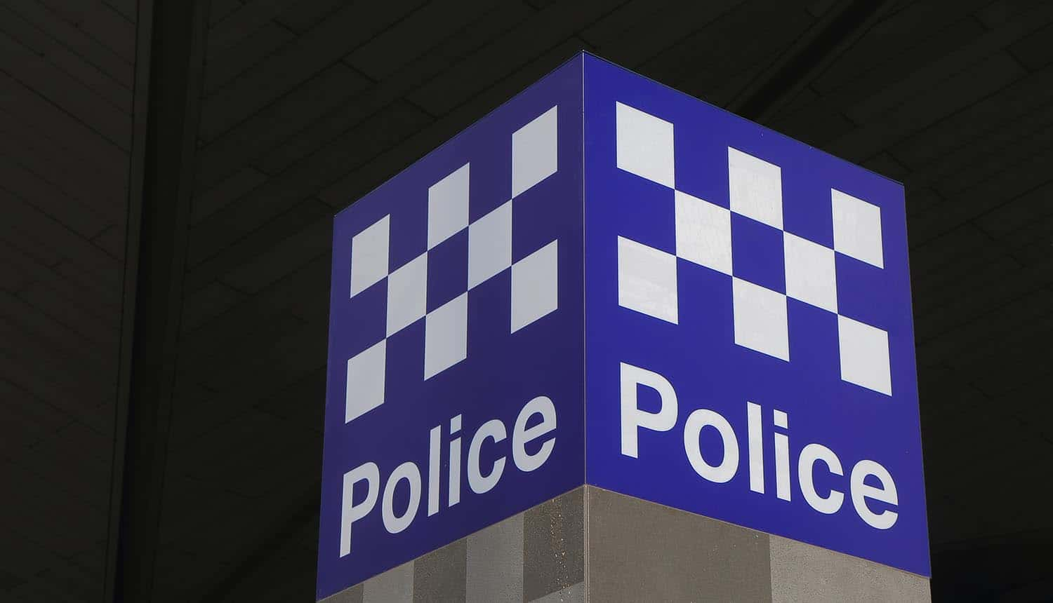 Australian Police. logo outside building showing surveillance bill targeted at cybercriminals