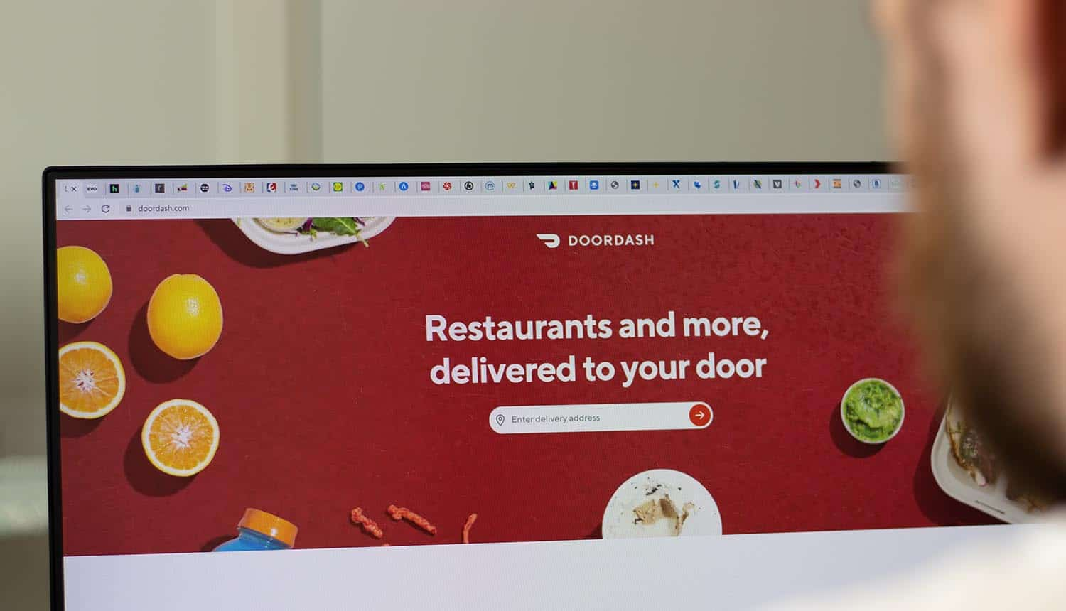 Doordash company website on screen showing data sharing by food delivery platforms