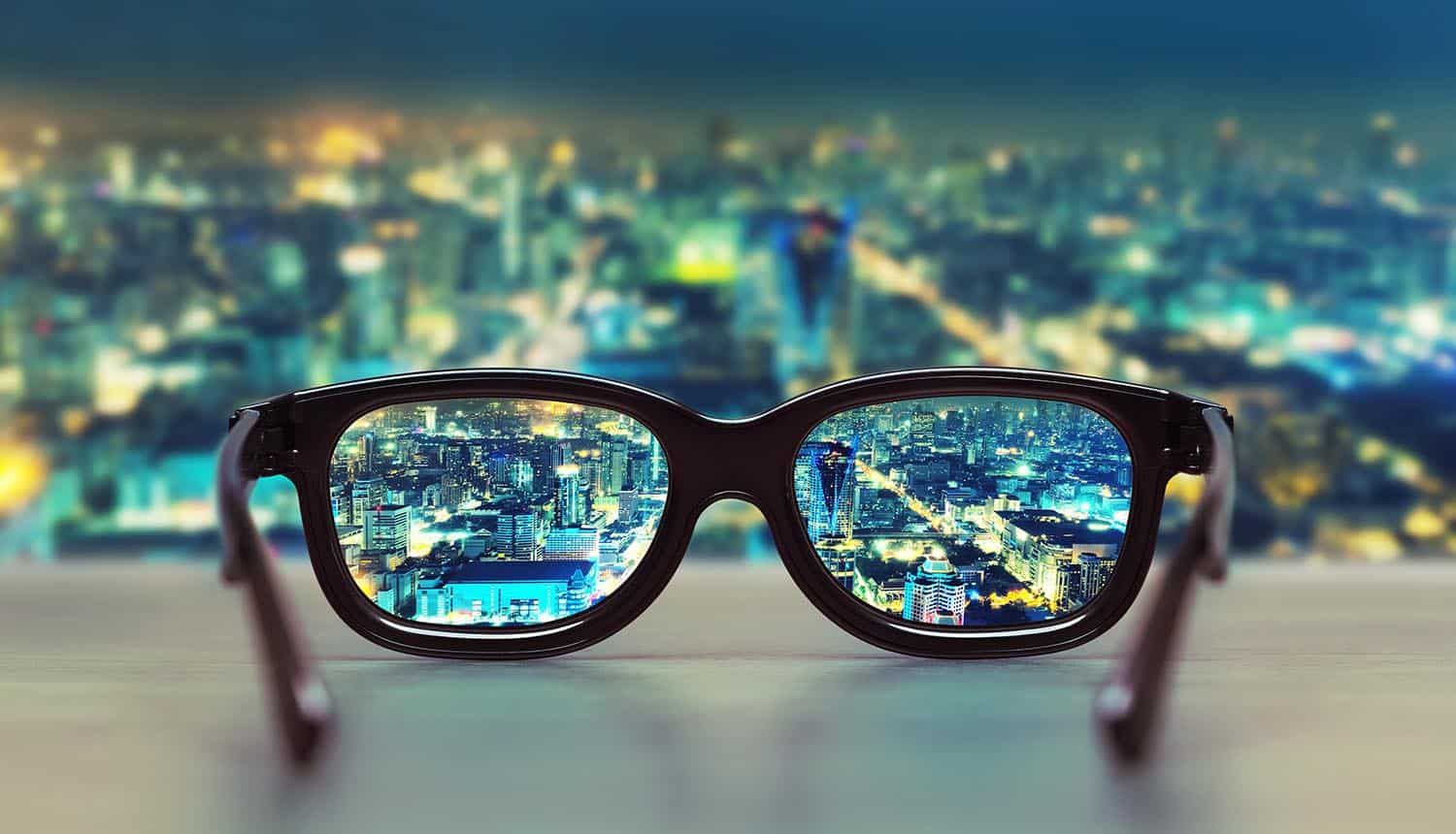 Night cityscape focused in glasses showing Facebook smart glasses