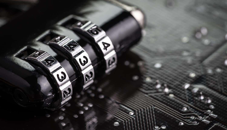 Combination pad lock on computer circuit board showing digital identity