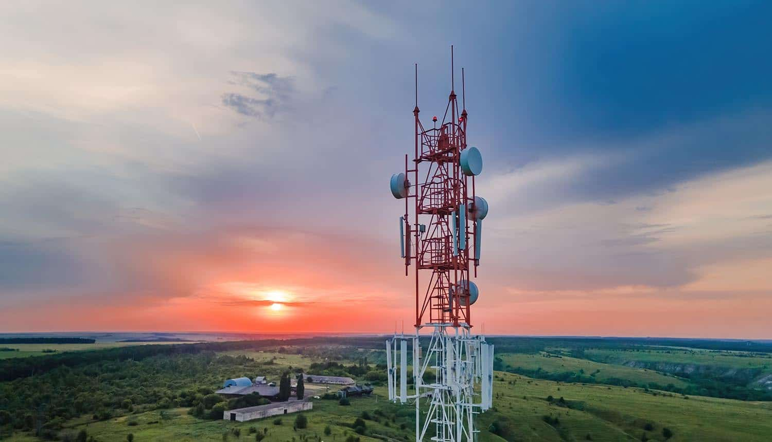 Telecommunication antenna receiver on cell phone tower with 5G showing challenge of legacy signalling protocols