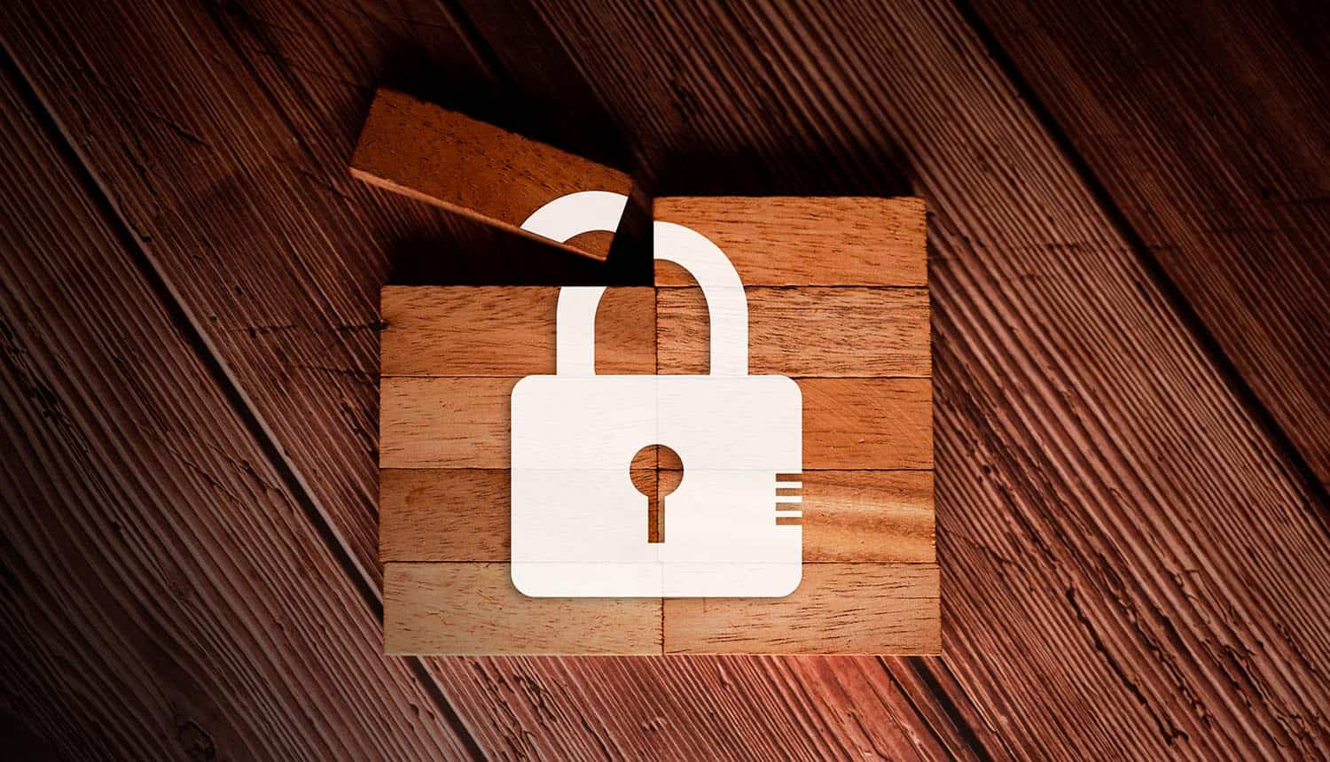 Lock image on wooden blocks showing online security & privacy