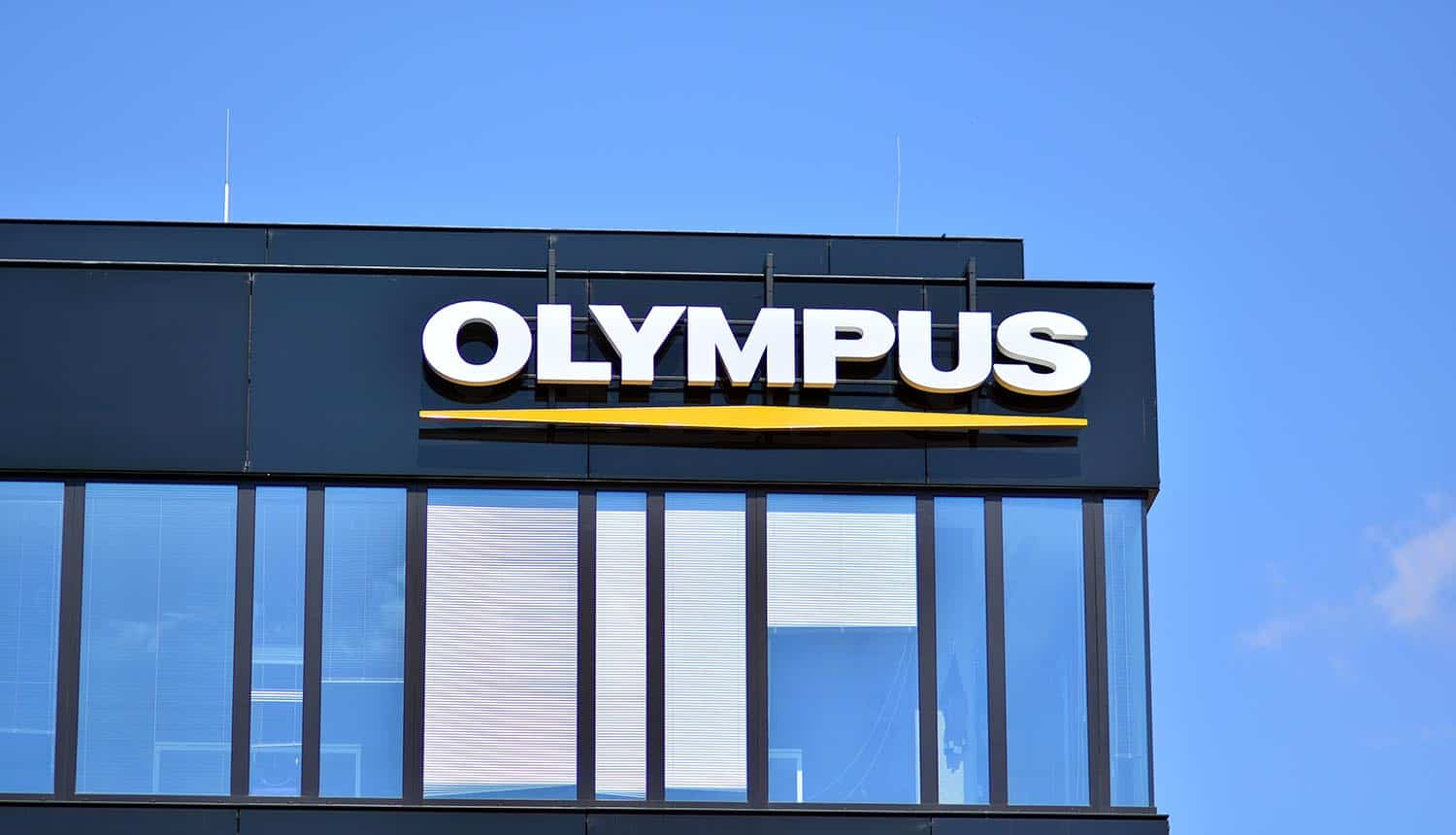 Company signboard Olympus on building showing ransomware attack