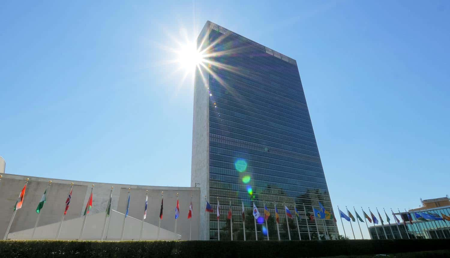 Sun shining behind United Nations building showing data breach