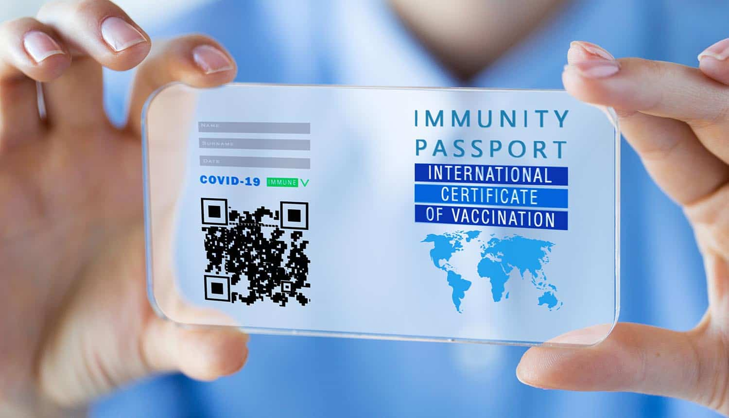 Woman's hands holding and showing COVID-19 vaccine passport