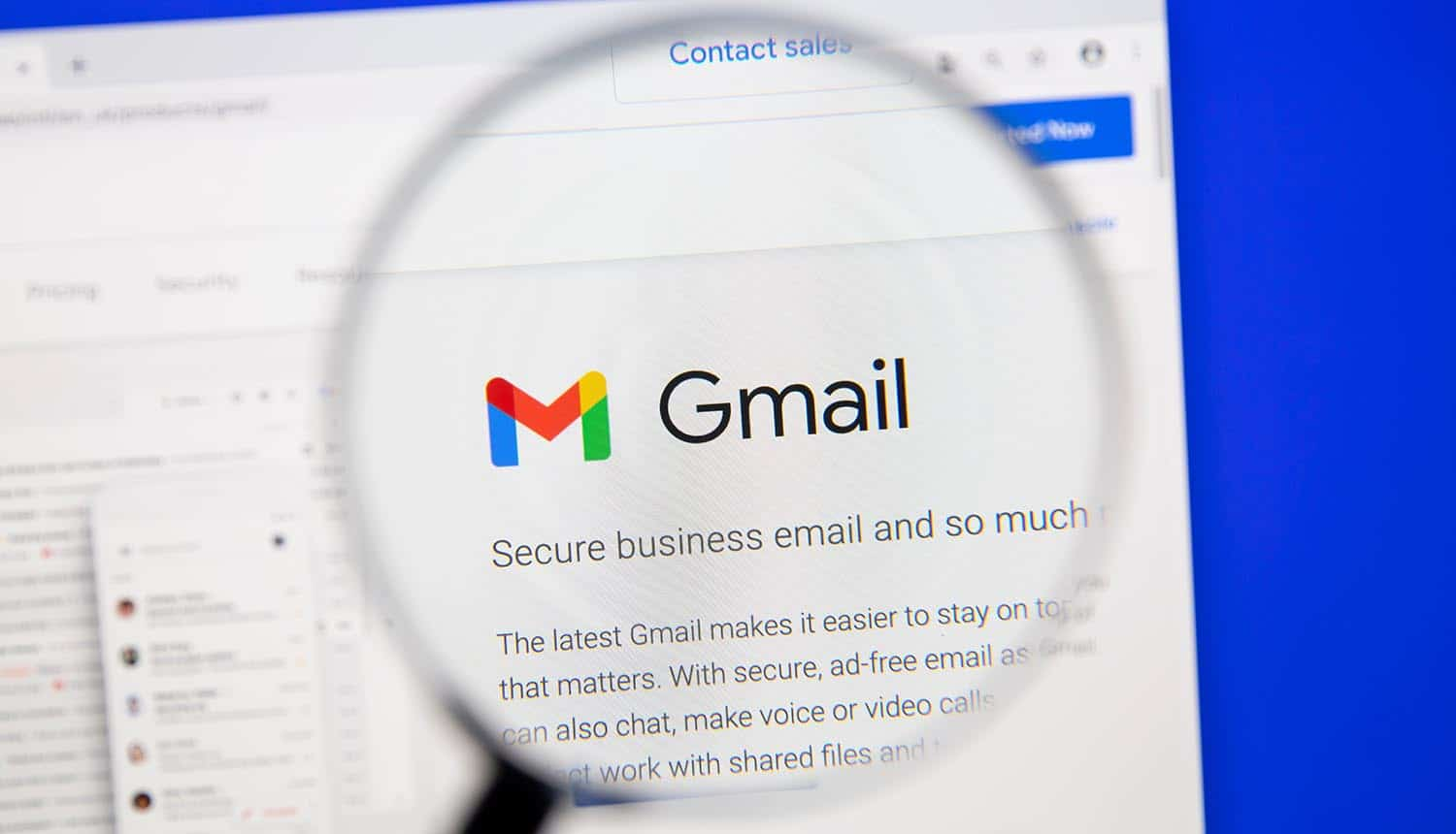 Google Gmail webpage under magnifying glass showing USB security key giveaway