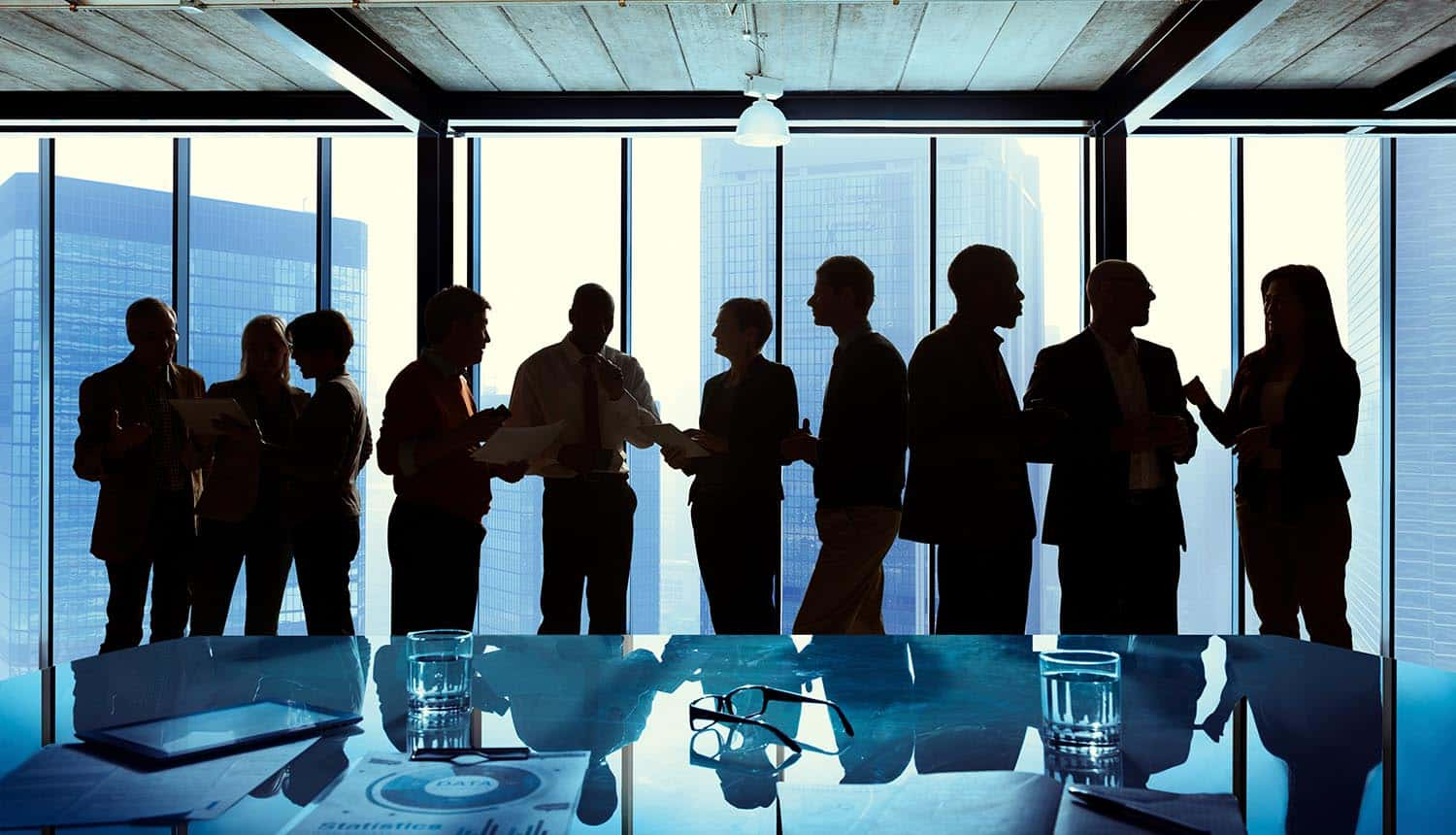 Group of business people talking in a meeting showing cybersecurity market