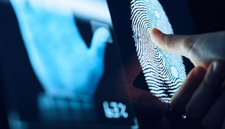 Man in front of fingerprint scanner showing identity system